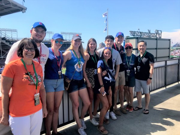 Yung Bong Lim '88 enjoys a Cubs game (pre-pandemic) with the 2019 PICS Chicago cohort.